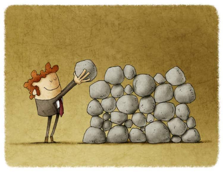 cartoon man building a wall using rocks
