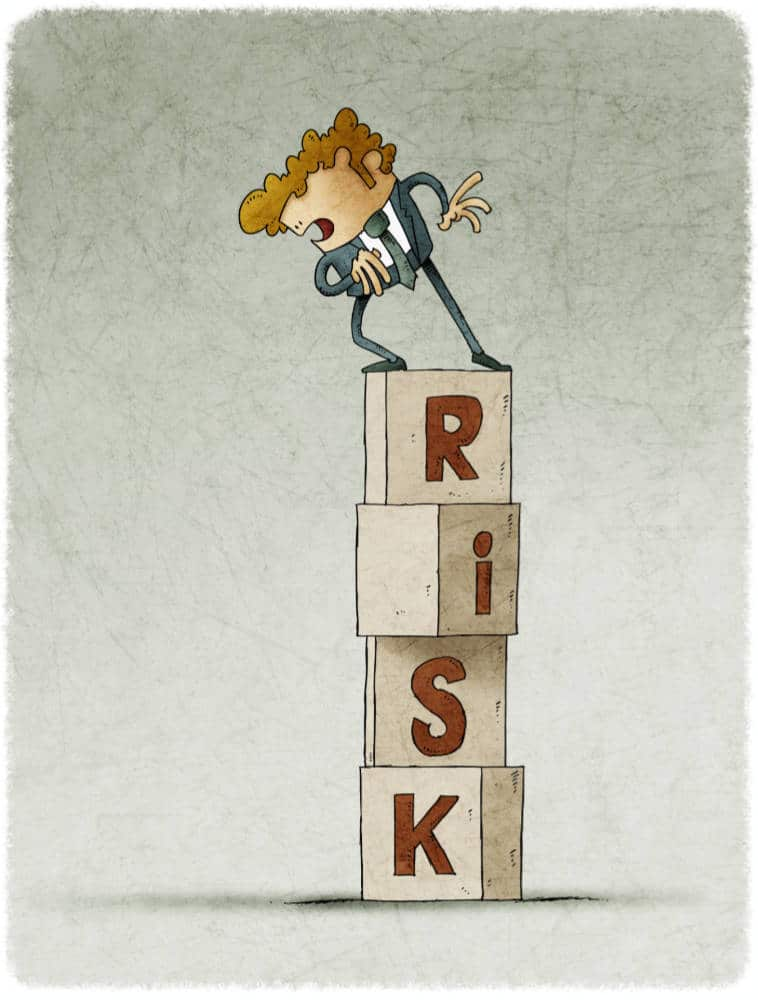 tower of cubes with the word risk in which there is a cautious man who looks down