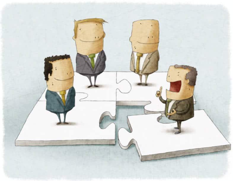 cartoon men standing on puzzle pieces